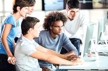 jb students behind computer peop